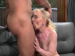 Old lady blows for facial
