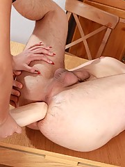 Perfect brunette dominatrix tearing slave's asshole with an immense strapon