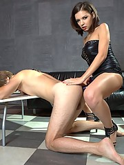 Slave's anus, still gaping from tail insertion, gets stretched with strapon