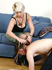 After a walk severe mistresses make slave lick leather boots clean