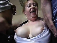 Horny granny enjoys two cocks