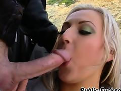 Busty broad eats rod outdoors
