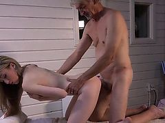 Skinny blonde gives old man erotic massage