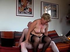 Busty blonde housewife in stockings fucks a hard rod every